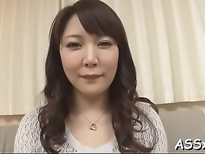 Cute asian receives raucous toying for their way cum-hole together with anal