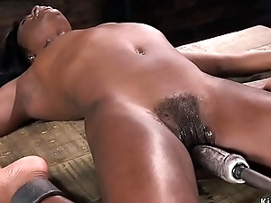 Muted ebony slave rides gender appliance