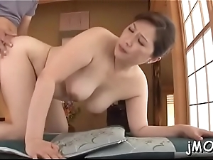 Beautiful oriental senior plays with water heavens her racy snatch