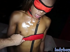 Spanking coupled with bareback anal of a dismal skinned transsexual